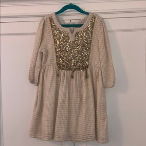 Girls gold and cream dress with sequin yoke